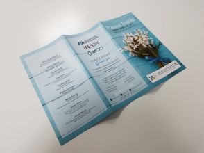 Outer side of the 5th Annual Breakfast brochure